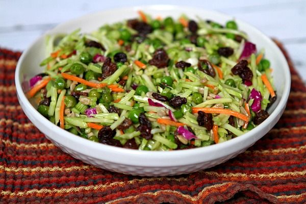 Broccoli Slaw Recipe Salads with granulated white sugar, cider vinegar, olive oil, water, light mayonnaise, dijon mustard, Tabasco Pepper Sauce, salt, pepper, broccoli slaw, frozen peas, green onions, raisins, roasted sunflower seeds