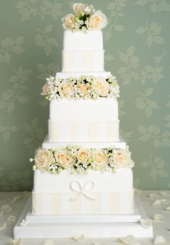 I love this three tier wedding cake with square tiers.  The blush roses are a gorgeous detail.    ᘡղbᘠ