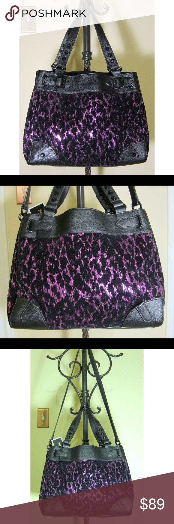 NWT Juicy Couture purple animal print shoulder bag 💜NWT💜FABULOUS Juicy Couture purple animal print shoulder bag. This purse is a fashion statement! Brand new, very spacious 😍. Interior features one zip compartment and two organizer pockets. You can wear it with the long shoulder strap (detachable) or the shorter handles. Such a beautiful bag!!! Juicy Couture Bags Shoulder Bags