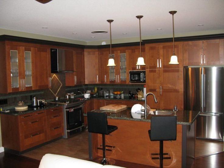Brown Kitchen Cabinets With Rectangular Kitchen Island And Granite  Countertop. Part 60