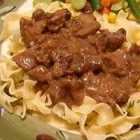 Crock Pot Beef Tips and Noodles 2lbs beef tips 1 can cream of chicken soup 1 container sour cream 1 pkg of lipton onion soup 1 pkg of egg noodles  Put beef in crock pot. In a separate bowl, mix soup, sour cream, and onion soup mix together. Pour over beef. Cook on low 6-8 hours Serve over cooked noodles.