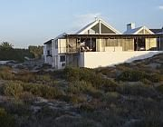 At The Beach This perfect beach hideaway is beautifully situated on the beach, ideal for those who want to catch the early morning surf. Relax on the deck watching the dolphins play.   This architect designed (Johan du Toit), beautiful house will give you a wonderful break from your busy lifestyle at any time of the year. Muted earthy tones and furniture, hand made Fibre Design african rugs from Swaziland, #locationshoot #photoshoot