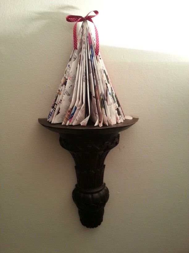 Cute easy Christmas tree on sconce,  made from a folded magazine.  Make lovely decorations along a runner.  Can be spray painted.