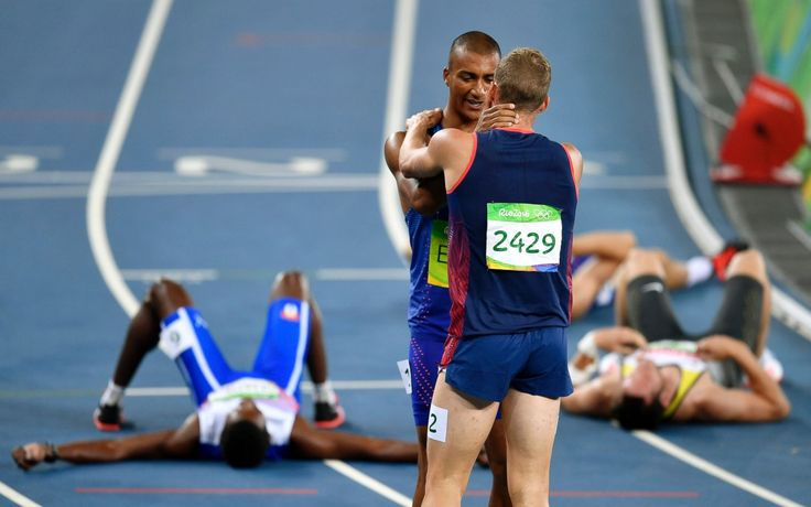 USA's Ashton Eaton embraces France's Kevin Mayer after competing in the men's…
