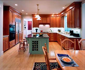 Decorating Above Kitchen Cabinets By Wrapping Soffits With Same Wood As  Cabinets And Adding Large Crown