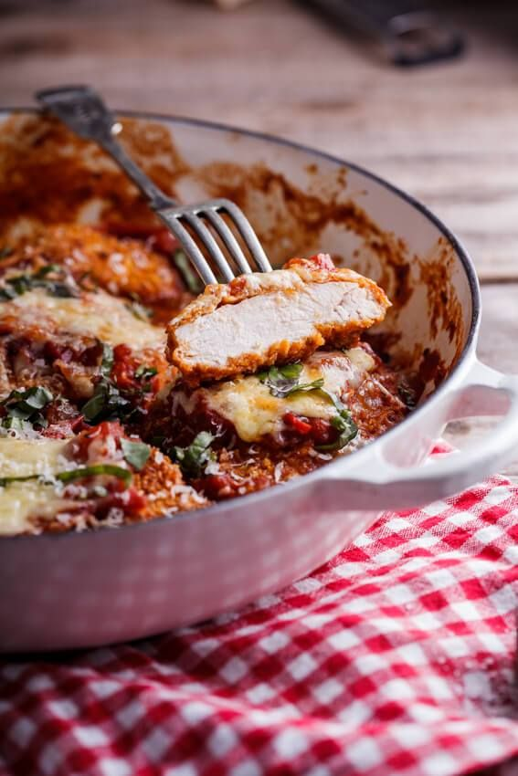 Crispy corn flake Chicken Parmesan in rich marinara sauce - simply-delicious-food.com