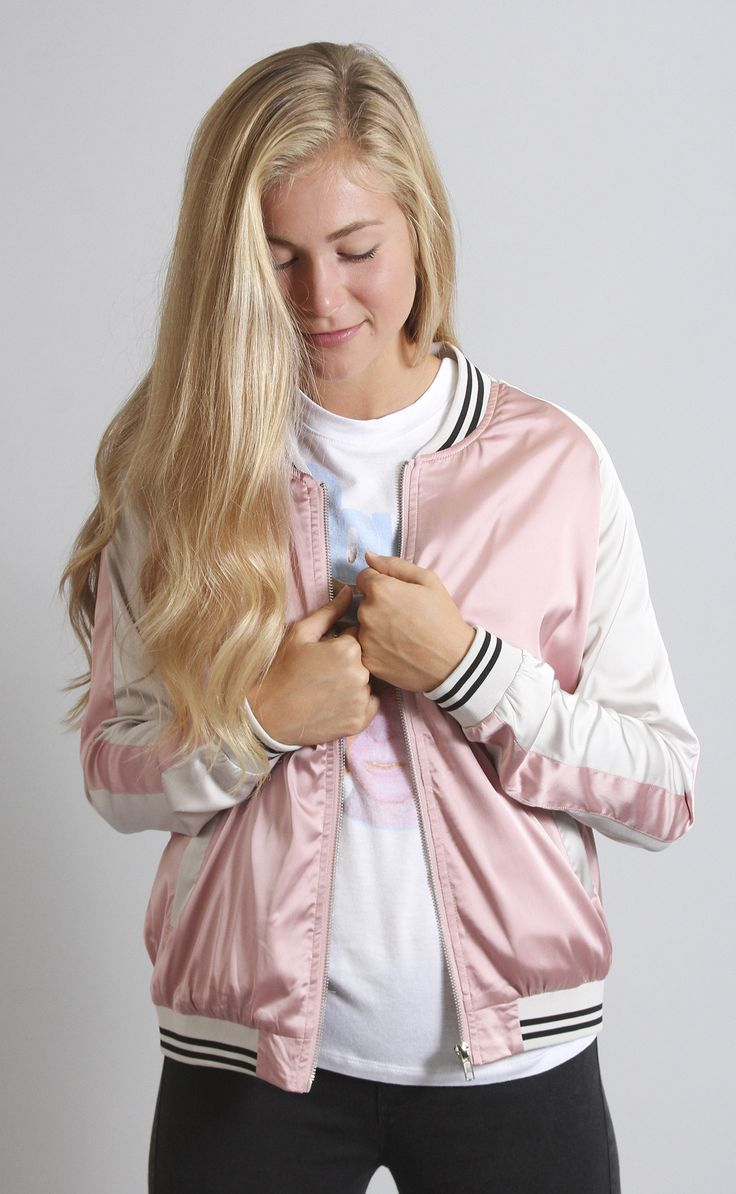 Too pure to be pink?? Channel your inner cool girl in this pink satin bomber jacket! We don't know about you, but we're feeling major Grease vibes in this super chic number. It features stretchy ribbe