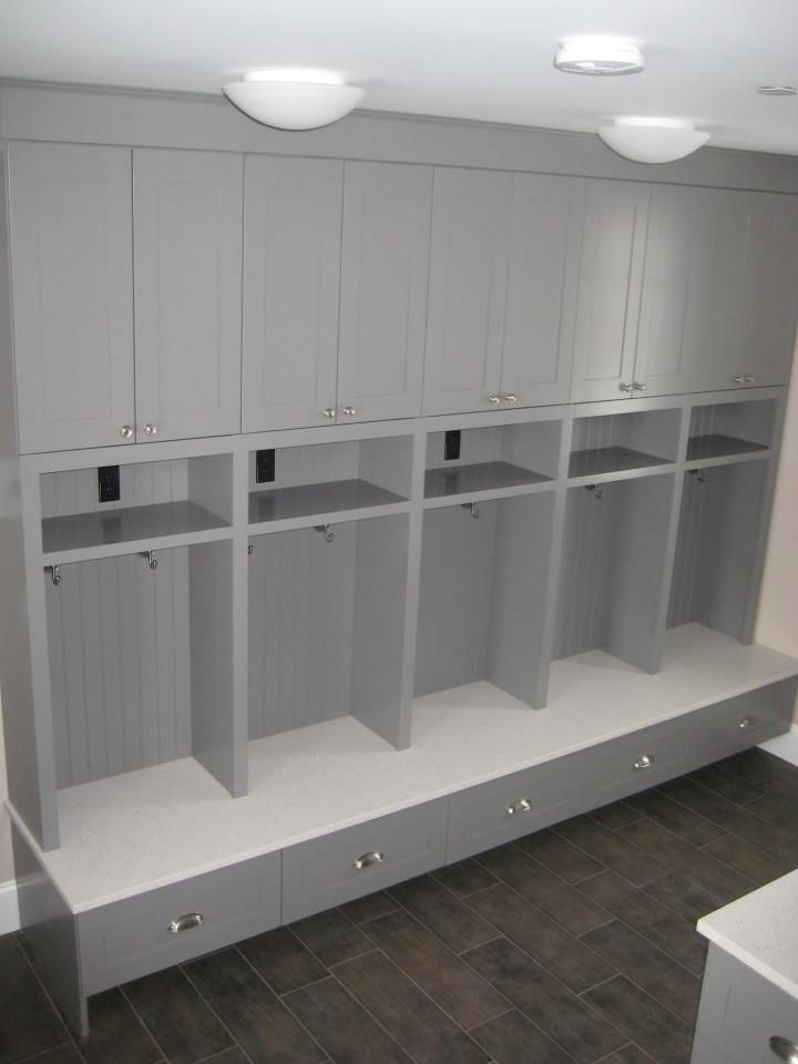 Entry or Garage idea, each nook includes a power socket for recharging devices! (I would make the drawers go all the way to the floor though, to maximise shoe storage)