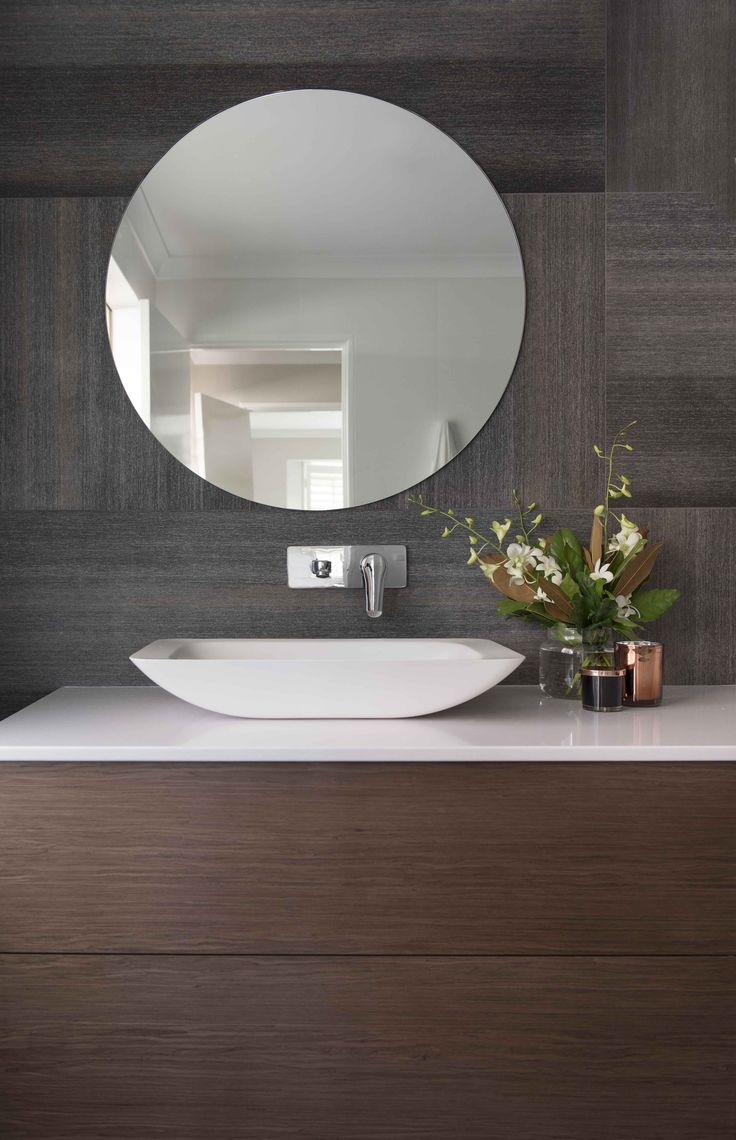 Red Lily Renovations - Perth. Large 1200x600 rug tile. Wood veneer floating vanity with push to close. 2100 wide. Wood vanity. Round mirrors create a softness to the room contrasting the lines in the tiles.