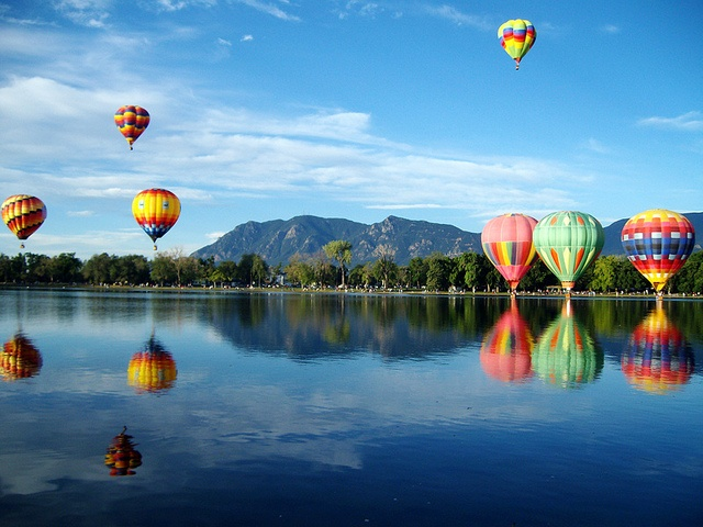 Hot Air Balloons reflected in Prospect Lake, Colorado Springs, Colorado. The Colorado Balloon Classic is the largest and the longest continuously running hot air balloon festival in the Rocky Mountain Region as well as the State of Colorado.