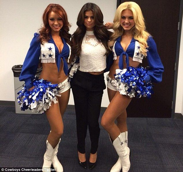 Halftime performer: Selena Gomez posed with two Dallas Cowboys cheerleaders in a photo shared on Sunday via Twitter