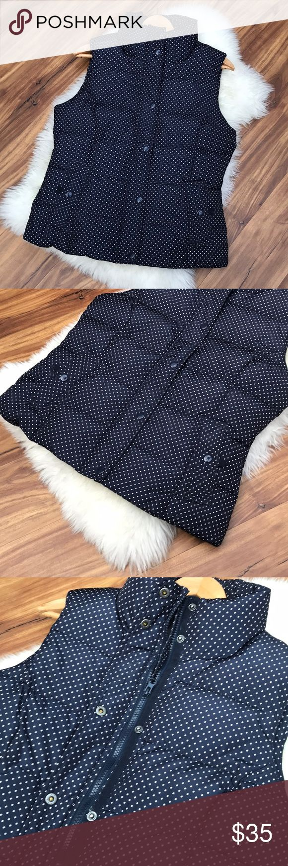 Polka dot down puffer vest Like new! Worn very gently & no signs of wear. Warm puffer vest style in navy blue with light pink polka dot. Shell & lining are 100% polyester. Filler is 50% down & 50% waterfowl feathers. Bass Jackets & Coats Vests