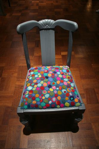 refurbished chair with colorful felt pebbles by Ruth Singer