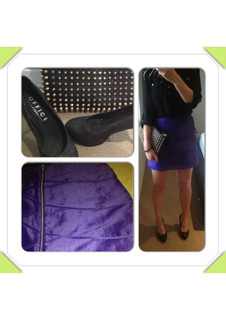 Purple ruffled skirt with black studded bag, black shirt and high heels.