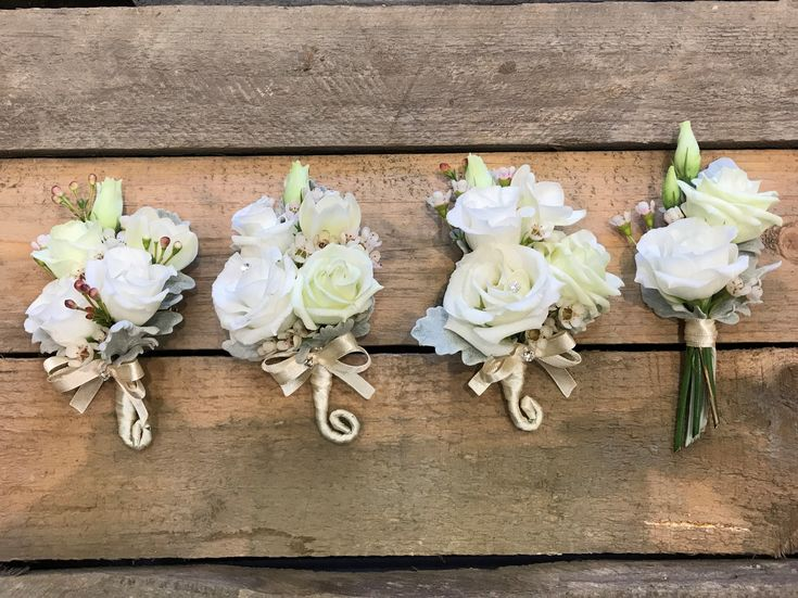 Boutonnieres: White Lisianthus, White Wax Flower, Silver Leaf tied with satin ribbon.