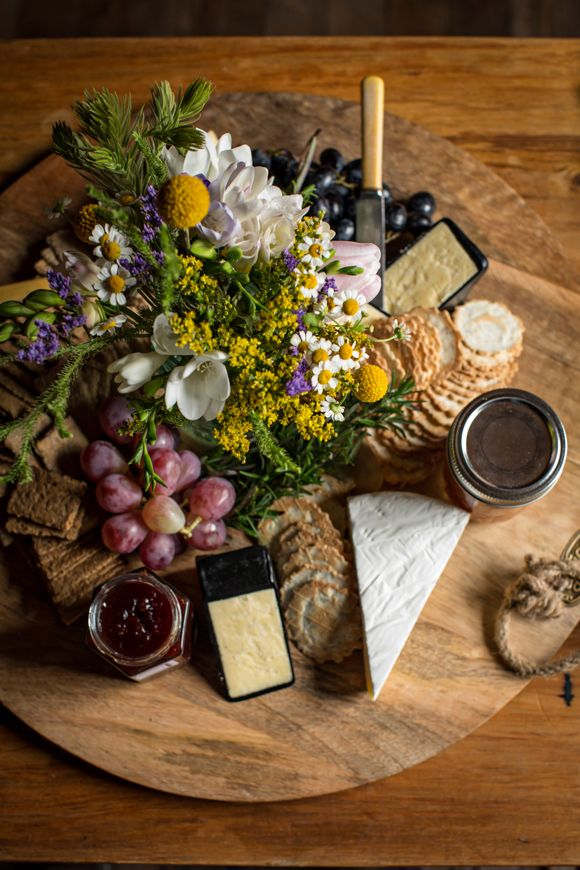 rustic cheese boards for each of the tables | via: magnolia rouge