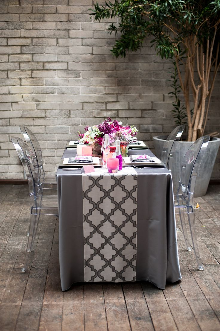 Gorgeous gray table with pops or purple and pink, photo by Nikki Closser  | via junebugweddings.com