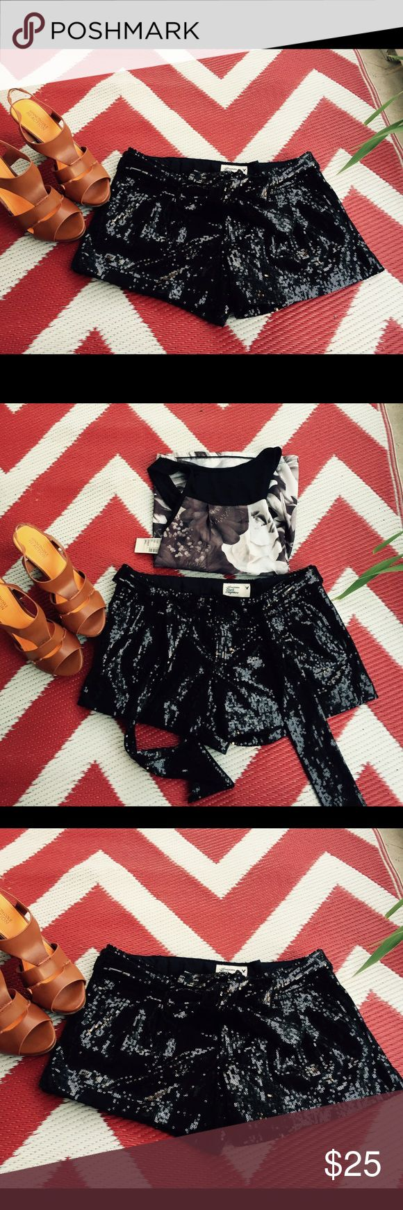 """American Eagle Black Sequined Shorts Gorgeous shiny black sequins shorts by American Eagle Outfitters. Fully lined with tie belt. Stretch. Size 0. Like new condition. Cute for date night with girl friends and pair it with heels or booties. Inseam: 3.5"""" American Eagle Outfitters Shorts"""