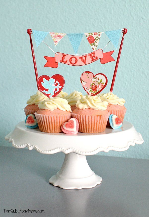 The ultimate Valentine's Day cupcakes -- Pink Velvet Cupcakes With Cream Cheese Buttercream Frosting. Pretty and delicious with Bakery Crafts decorations.