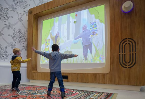 Creative Review - Playtime at The Royal London's Children Hospital    ...characters...can be interacted with onscreen by moving around in front of the screen. Entitled Wiggle Wood, the installation allows children to enter into a storybook-style illustrated world....