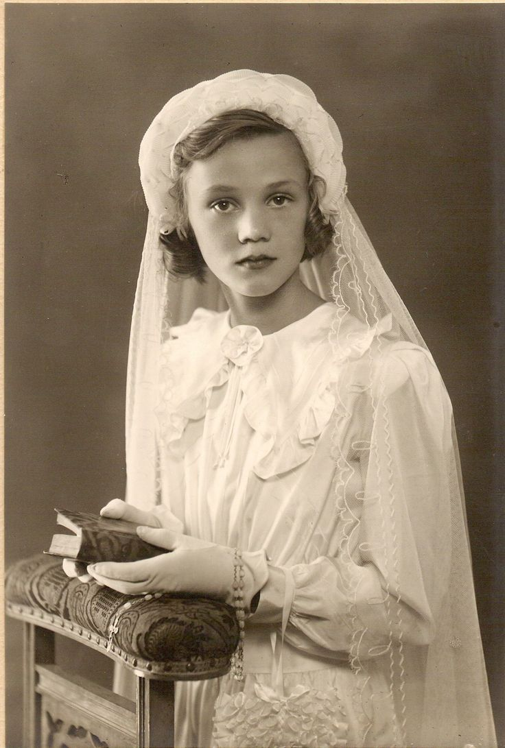 My mom between 12 and 14 posing for her solemn communion