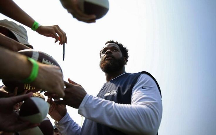 Seattle's Pro Bowl defensive end sat a day after former teammate Marshawn Lynch did the same before an Oakland Raiders preseason game.