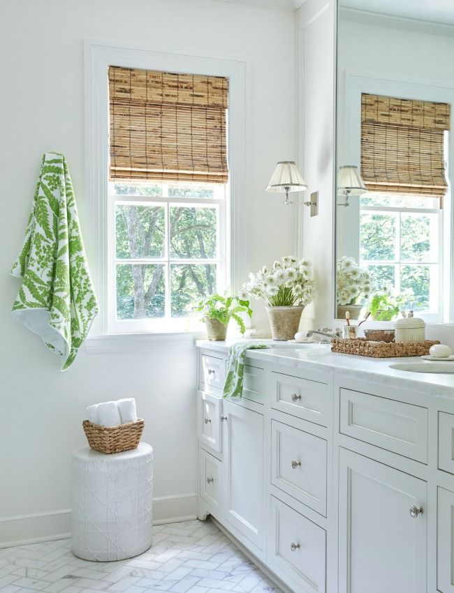 Green And Natural Touches In An All White Bathroom