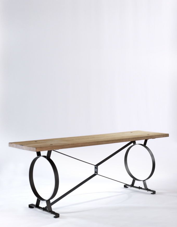 BB for Reschio - The Etruscan Factory Sofa Table - A raw oak and ebonised steel sofa table. B.B. -Inspired by Etruscan designs, it can be used either behind a  sofa or as a great object table against the wall. Its construction allows for a rather satisfying springiness. I love the rebated steel discs in the top. www.reschio.com