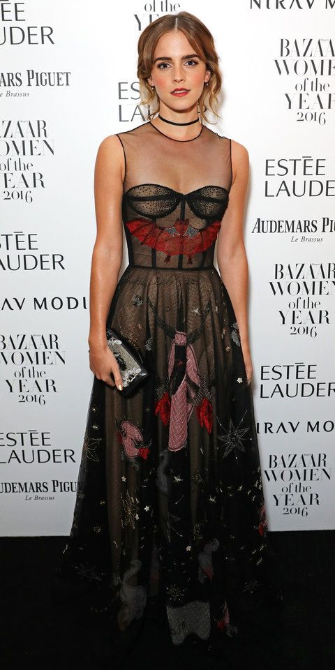 """Emma Watson tapped into the Halloween spirit and arrived on the black carpet in a bewitching black """"Le Diable"""" Dior gown embroidered with bat motif all over, complete with a silver Dior clutch and a black choker."""