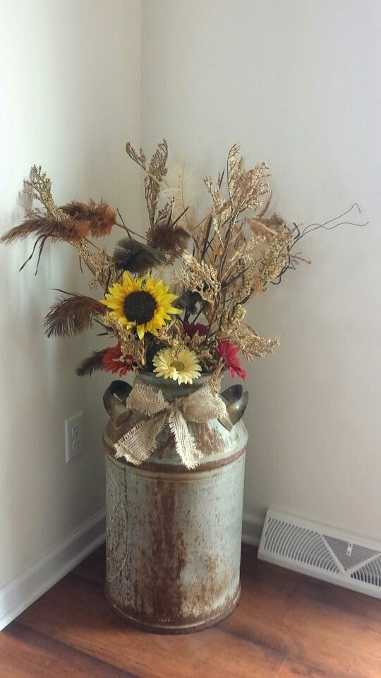 Country rustic decor milk can, fall flowers, and burlap