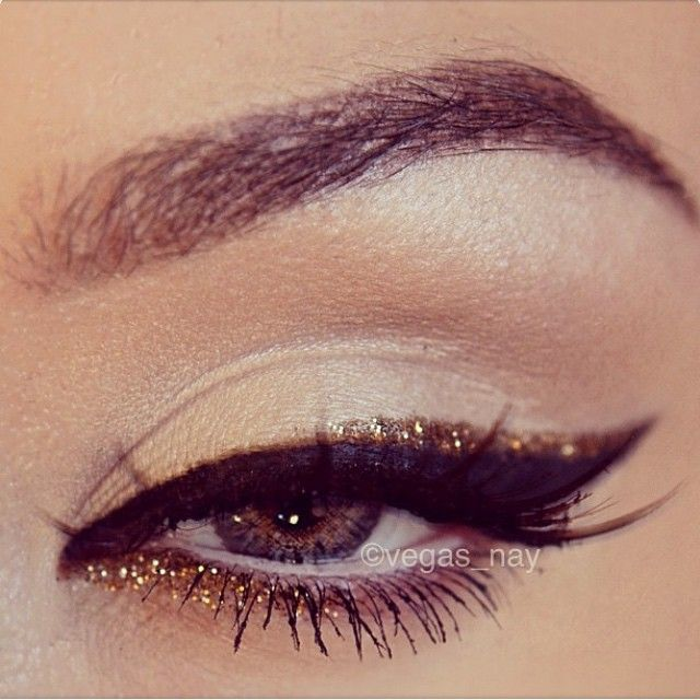 """vegas_nay #oldie by @vegas_nay using Revlon's liquid liner for cat wing, then wash the Revlon brush w/ water until it runs clear; then mix Sally Girl """"Gel Adhesive for glitter"""" (found at Sally's) & GLIMMER Los Angeles """"Bronze"""" loose glitter, and use the Revlon wand to apply a perfect line above the black liner. Add a smidgen on inner lower lash line #vegas_nay"""