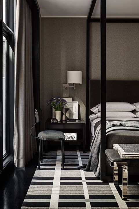masculine bold color bedroom black canopy bed patterned black white grey carpet via mark cunningham inc - Carpet Canopy Decorating