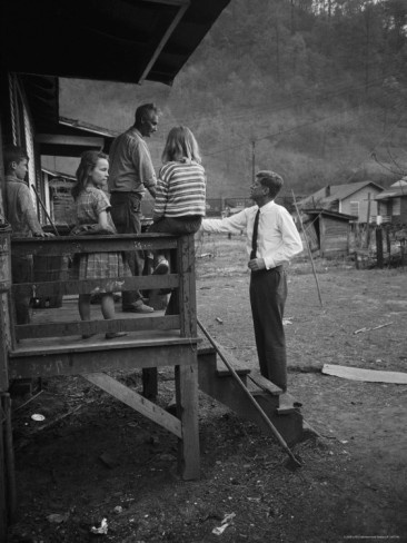 John F. Kennedy meets a family in West Virginia while campaigning for president.