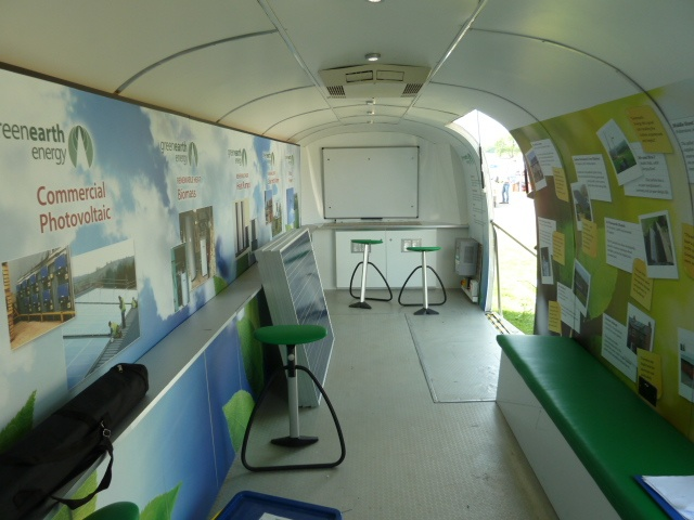 Greenearth renewable energy information. Branded interior of the Silver Bean Airstream