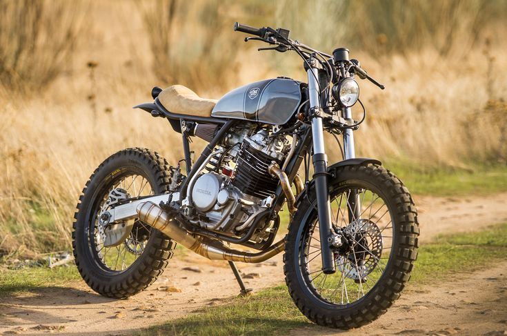 Nice high stance, like it could actually work off-road. Seat is cool too, very simple (Honda XR600)