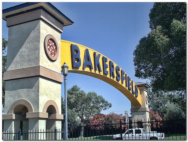 Bakersfield, California, USA. The Bakersfield sign was originally on Union Avenue, crossing a busy street and connecting two parts of a hotel. Despite being one of the most famous images of the city, the sign was allowed to fall into disrepair after the hotel was abandoned. When Buck Owens opened his Crystal Palace restaurant and concert hall, he paid to have the sign renovated and moved to outside the entrance to his facility.