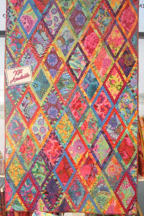 Bordered Diamonds by Kaffe Fassett Quilt  Use Fons and Porters 60 degree diamond ruler and plenty of starch for those bias edges
