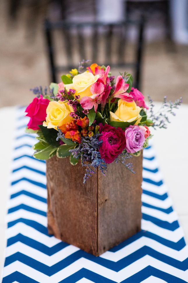 Use rustic boxes to complement bright floral arrangements.