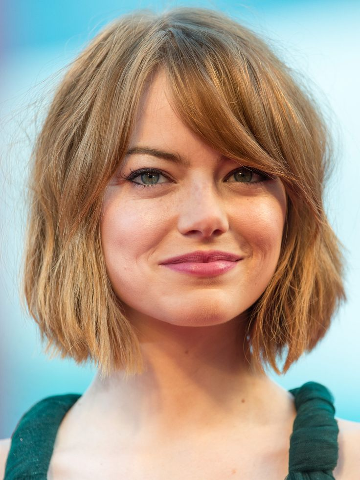 """Emma's blunt, shaggy cut is super-cool but could look harsh without the sideswept fringe. """"The bangs create a point of interest and help the color pop even more,"""" says Cutler. Getty Images   - Redbook.com"""