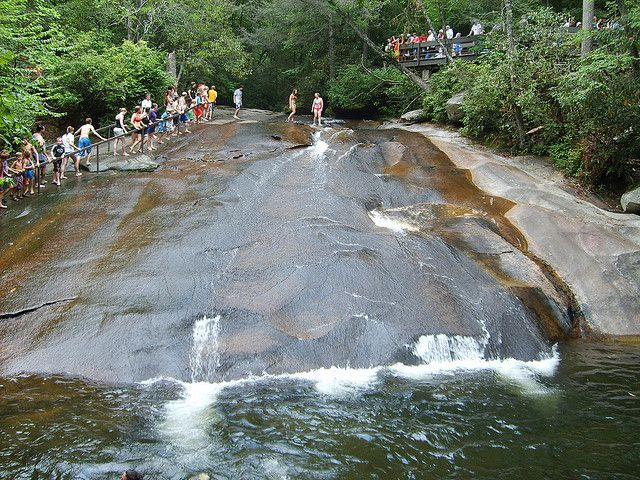 Sliding Rock in Brevard, North Carolina is a 60′ waterfall set on a very gentle slope. Swimmers slide down the rock into a cold 8′ deep pool.