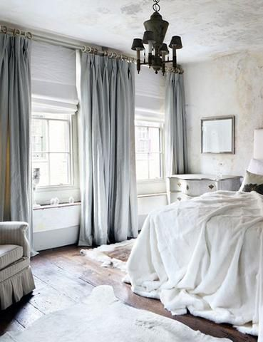 luxurious bedroom with pale blue velvet curtains