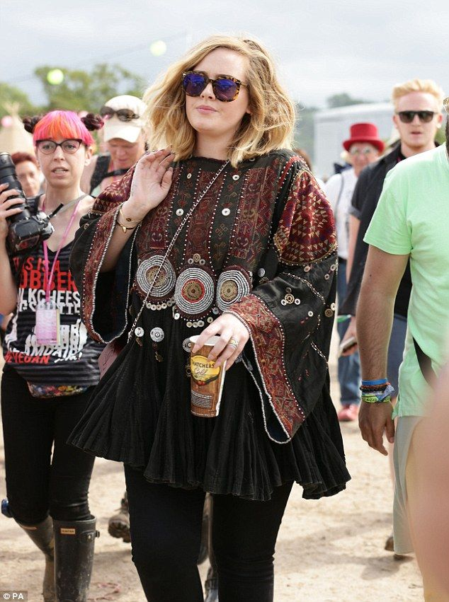 Not going unnoticed: Despite her large showbiz shades, the singer was extremely recognisab...