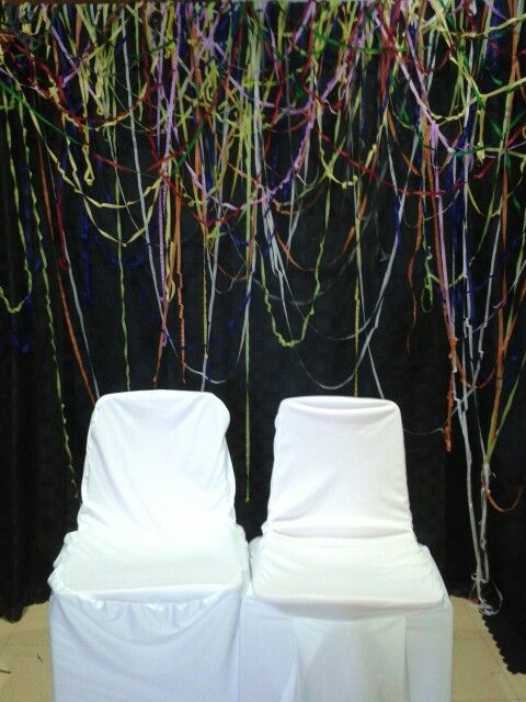Party trick- quick diy photo booth.... put black table cloths over gazebo and add choice of colours of streamers.