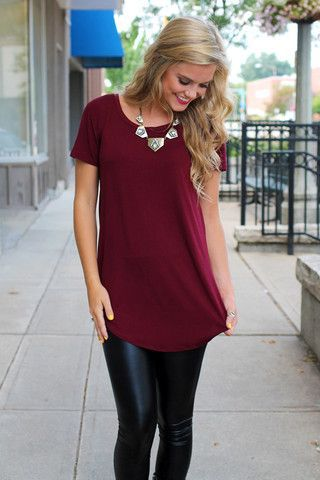 keep it simple with a long solid tee, and add a statement necklace to make sure it's not too boring.