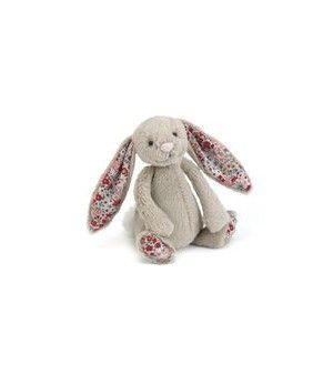 Tout doux, tout beau, super tendance! Le doudou lapin beige, avec son tissu imprimé fleur sous les pieds et dans les oreilles, sera le compagnon idéal de votre nouveau-né.Existe en petit et grand model.