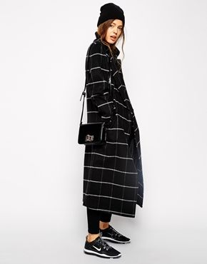 A prim coat looks good with swoosh.  ASOS Coat in Oversized Fit in Check