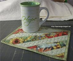Lots of mug rugs   like the use of decorative stitching for quilting