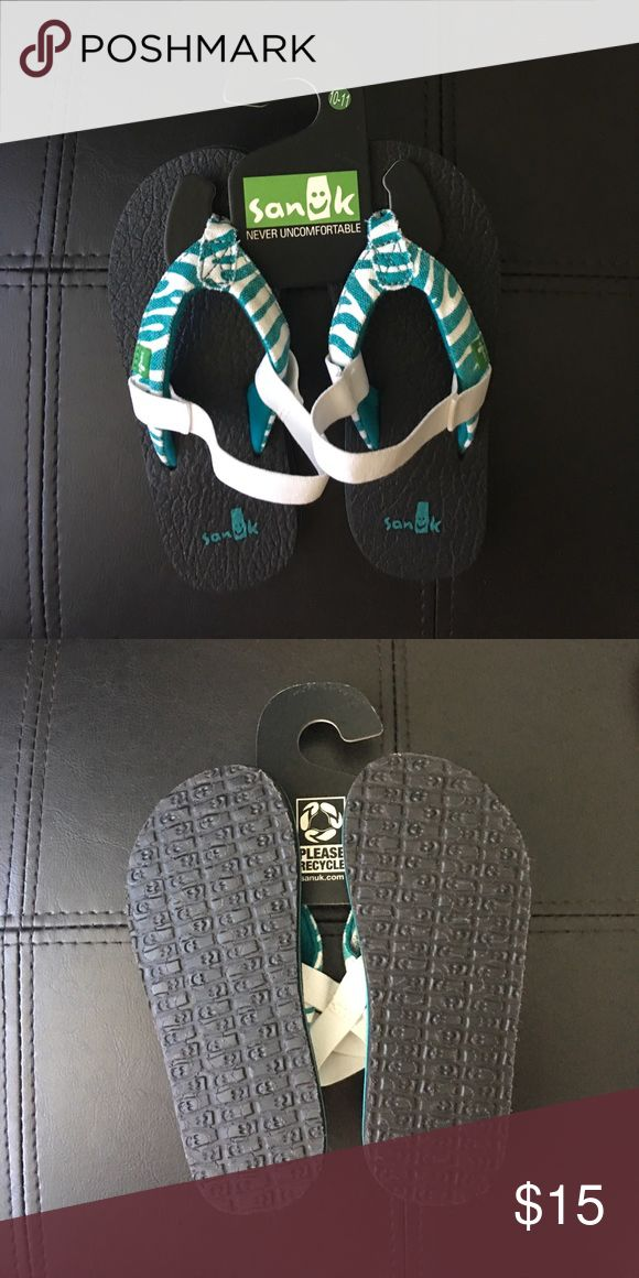 Sanuk kids Canvas Flip-Flops sz 10-11 New, never worn toddler Sanuk flip-flops, canvas + rubber band on the back. Sanuk Shoes Sandals & Flip Flops