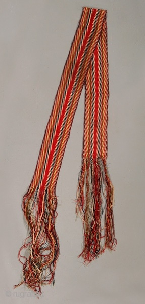 By the 1800s, a mixture of Cree, Scots, Quebecois, Athabascan peoples in Canada had developed a culture known as Métis. These sashes have become an iconic symbol for that/ those culture(s), and even for Canada as a nation. The earliest and most intricate versions were braided ('finger-woven'), but later on loom-woven versions were made for commerce/ trade. Ceinture fléchée, free-end braiding, finger weaving, Métis sash