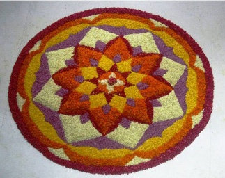 Rangoli Pattern made with flowers and flower petals for the festival of Onam in Kerala, India